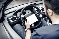 Car driver with the Tablet PC Royalty Free Stock Photo