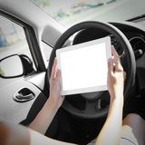 Car driver with tablet pc Royalty Free Stock Photography