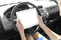 Car driver with tablet pc Stock Images