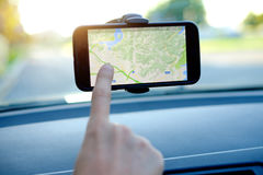Car driver using a gps mobile Stock Image