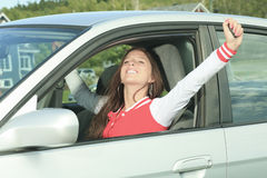 Car driver woman happy. Car driver woman having good time hand high Royalty Free Stock Image