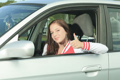 Car driver woman happy. A Car driver happy showing is thumb up Stock Photography