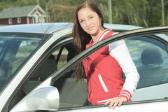 Car driver woman happy. A teen enter in is brand new car Stock Photo