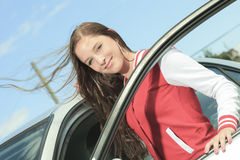 Car driver woman happy. A teen enter in is brand new car Royalty Free Stock Photo