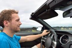 Car driver - young man driving convertible Royalty Free Stock Photo