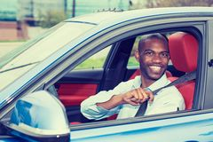 Car driver young man wearing safety belt driving new car