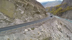 Car drives along the rocky road stock footage