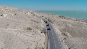 Car drives along the rocky road stock video footage