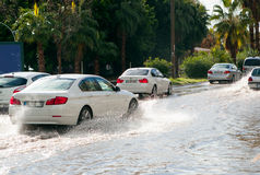 Car drives through flooded road in Mersin Royalty Free Stock Photo