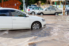Car drives through flooded road in Mersin Stock Photo