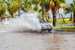 Car drives through flooded road in Mersin Stock Images