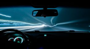 Car drives a photograph on the road with a delay inside view.  stock photos