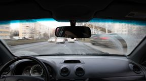 Car drives on the road during the daytime inside view.  royalty free stock photos