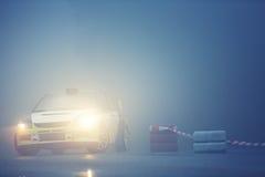 Car drives on rural road with fog. Sport car from drives on rural road with fog Royalty Free Stock Photos
