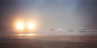 Car drives on rural road with fog. Sport Car drives on rural road with fog Royalty Free Stock Image