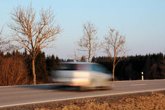 A car drives too fast Royalty Free Stock Photo