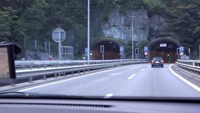 The car drives into a tunnel. Tunnel in Switzerland.Tunnel in Switzerland. Departure from the Swiss tunnel by car. stock video
