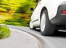 Car driving. Motion blur shot of a car driving in a curve stock photography