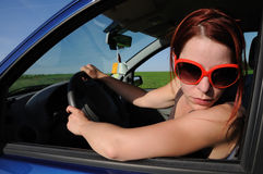 Car, driving. Girl in a car looking back, driving Royalty Free Stock Photo