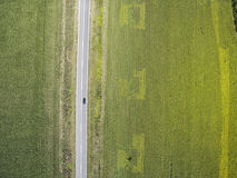 Car driving through agricultural fields Royalty Free Stock Images