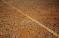 Car driving along desert road outback Australia Stock Photography