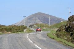 Car driving along road royalty free stock photos