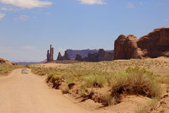 Car driving away in Monument Valley Royalty Free Stock Photography