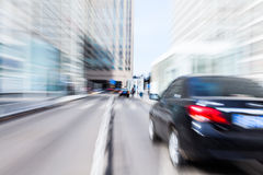 Car driving in the business district Royalty Free Stock Photo