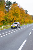 Car driving on country road. Royalty Free Stock Image
