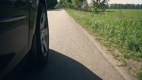 Close up wheel. Car driving on the country road details automobile drives slow motion stock video