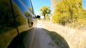 Car driving through the countryside. The camera is right outside. stock video footage