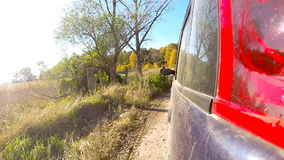 Car driving through the countryside in deep forest. stock footage
