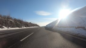 Car drive in winter, sunny day stock footage