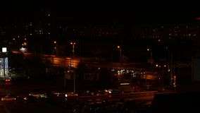 Car driving on crossroad in night city time lapse. Night traffic in modern city stock video