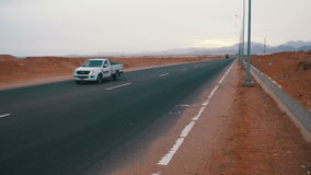 Car is Driving on the Desert Road stock video footage