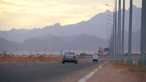 Car is Driving on the Desert Road stock footage