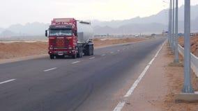 Car is Driving on the Desert Road. EGYPT, SOUTH SINAI, SHARM EL SHEIKH, NOVEMBER 29, 2016: Asphalt Road on the Desert. Car is driving on the desert road. Road stock video