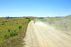 Car driving on a dirt road in Portugal Royalty Free Stock Images