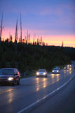 Car driving at dusk. Car driving under sunset in yellowstone national park stock photography
