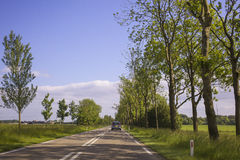 Car driving on an empty road Royalty Free Stock Photography