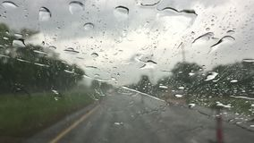 A car driving on expressway with heavy rain stock video footage