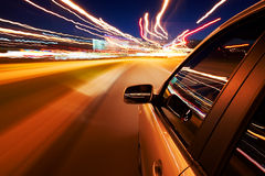 Car driving fast. On a night city road royalty free stock photos