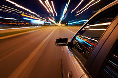 Car driving fast. On a night city road stock images