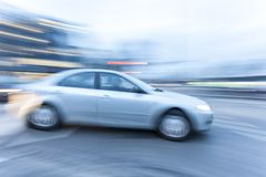 Car driving fast on country road Royalty Free Stock Photos