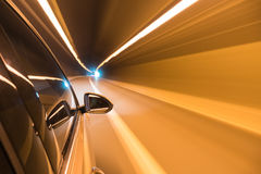 Car driving fast exit the tunnel Royalty Free Stock Photography