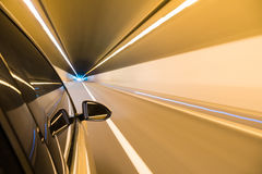 Car driving fast exit the tunnel Royalty Free Stock Photos
