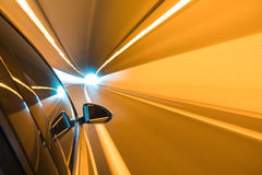 Car driving fast exit the tunnel Royalty Free Stock Photo