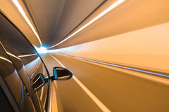 Car driving fast exit the tunnel Stock Image