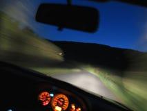 Car driving fast at night Royalty Free Stock Photo