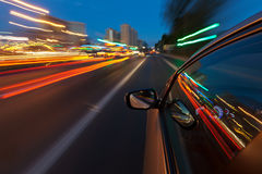 Car driving fast in the night city Royalty Free Stock Images
